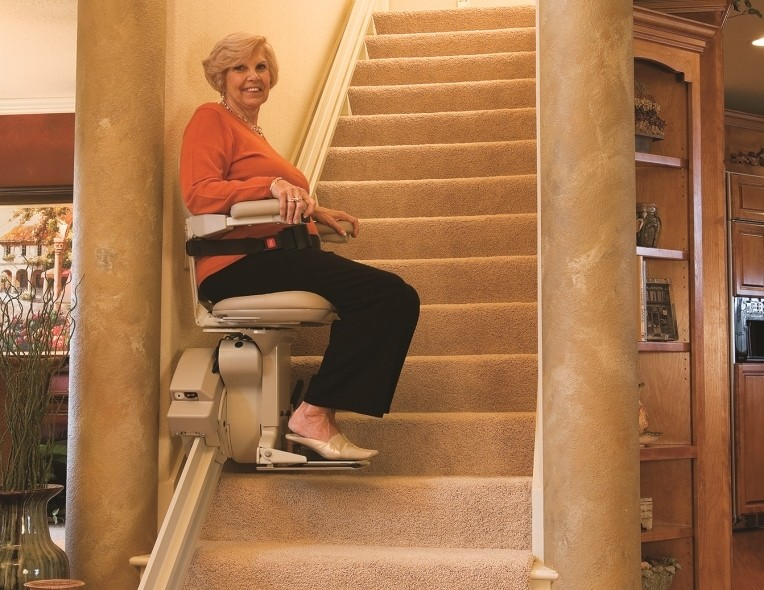 lady riding indoor stair chair lift