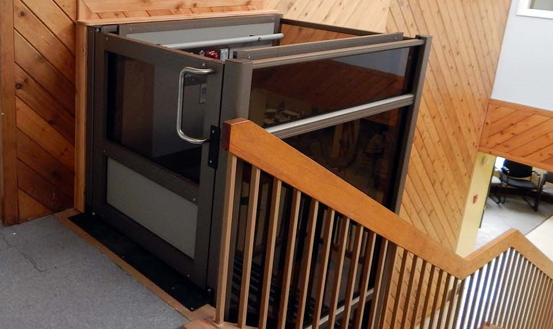 Vertical wheelchair lifts for schools