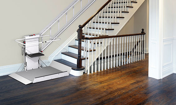 Inclined wheelchair lift on home stairwell