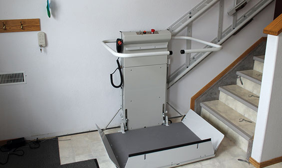 Inclined wheelchair lift at bottom of the stairs