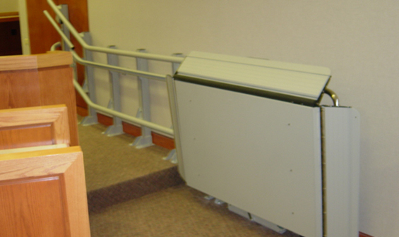 Indoor wheelchair lift in public building by Garaventa