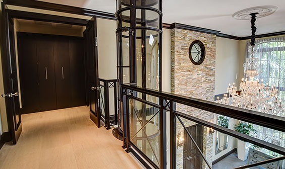 Pneumatic elevator on the second floor landing of a luxury home