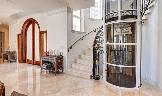 Pneumatic Vacuum Elevator next to a stairway in a luxury home