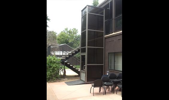 Exterior vertical wheelchair lift