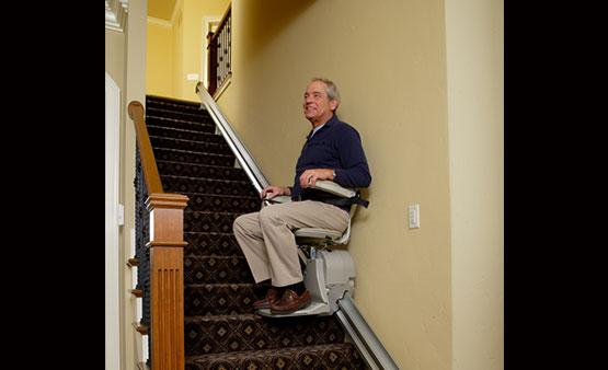 Man riding Bruno Elan Stair Chair SRE 3000