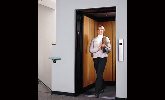 Woman using a Savaria Limited Use Limited Application Elevator