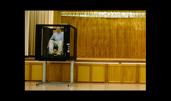Man using Ascension Protege vertical wheelchair lift to exit a stage