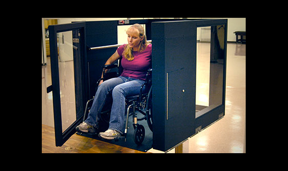 Handicapped woman using an Ascension Protege vertical wheelchair lift
