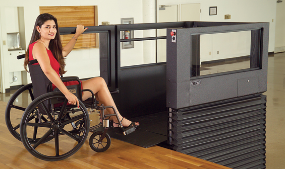 Woman using Ascension Virtuoso vertical wheelchair lift