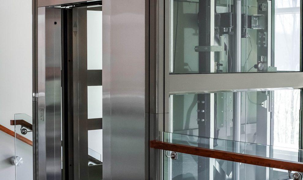 Garaventa glass elevator with metal trim