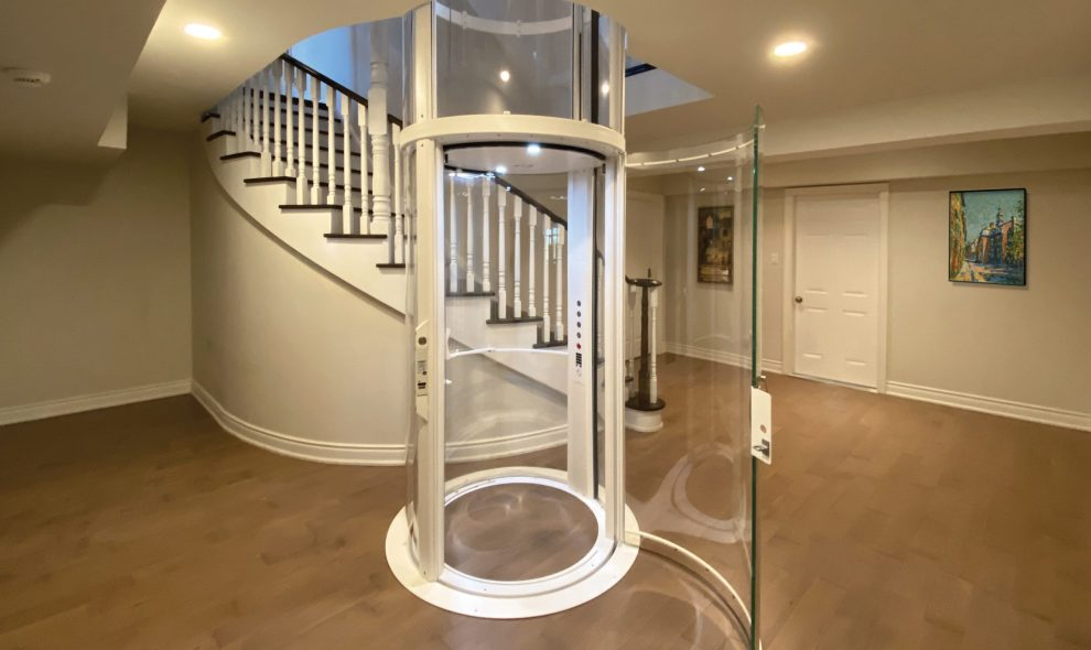 Round glass elevator in luxury home