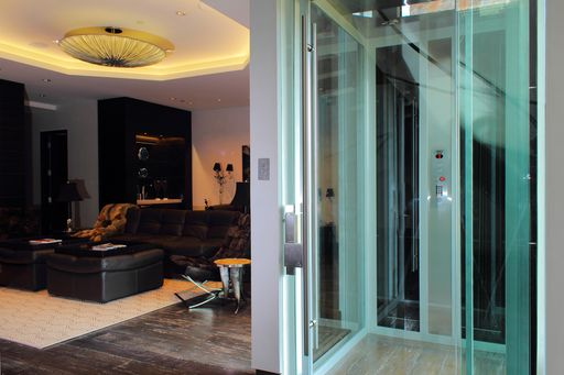 all glass paneled elevator in modern home