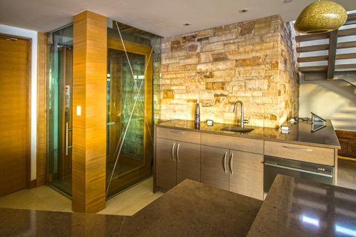 Glass elevator with wood trim