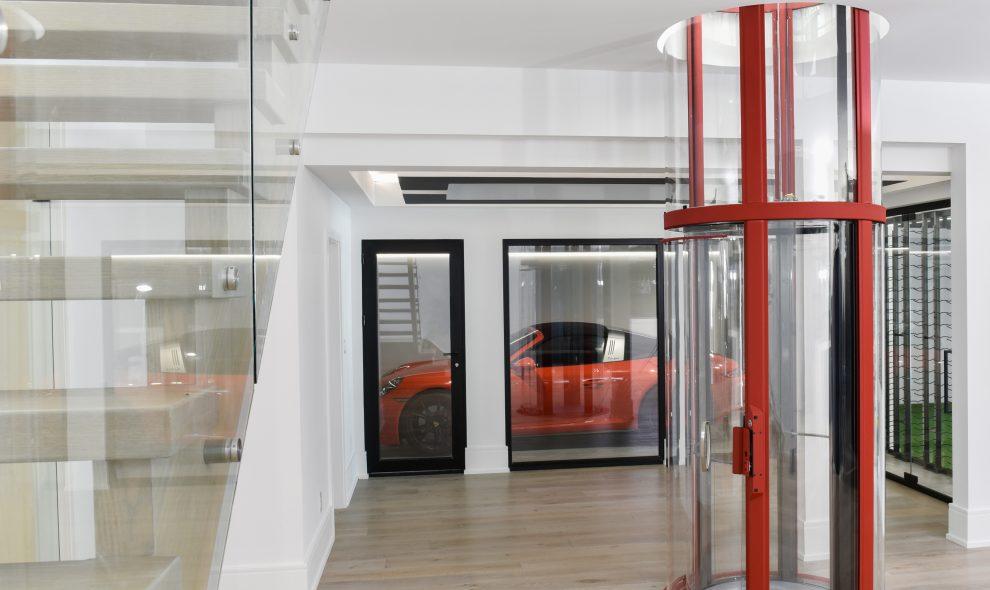 Round glass elevator with red trim